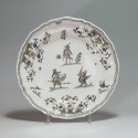 Moustiers - Plate decorated with grotesque - eighteenth century