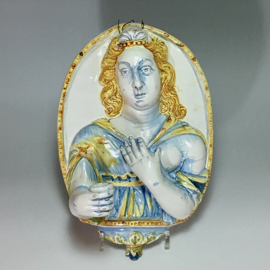 Nevers earthenware of the seventeenth century - plate forming an arm holding a candle