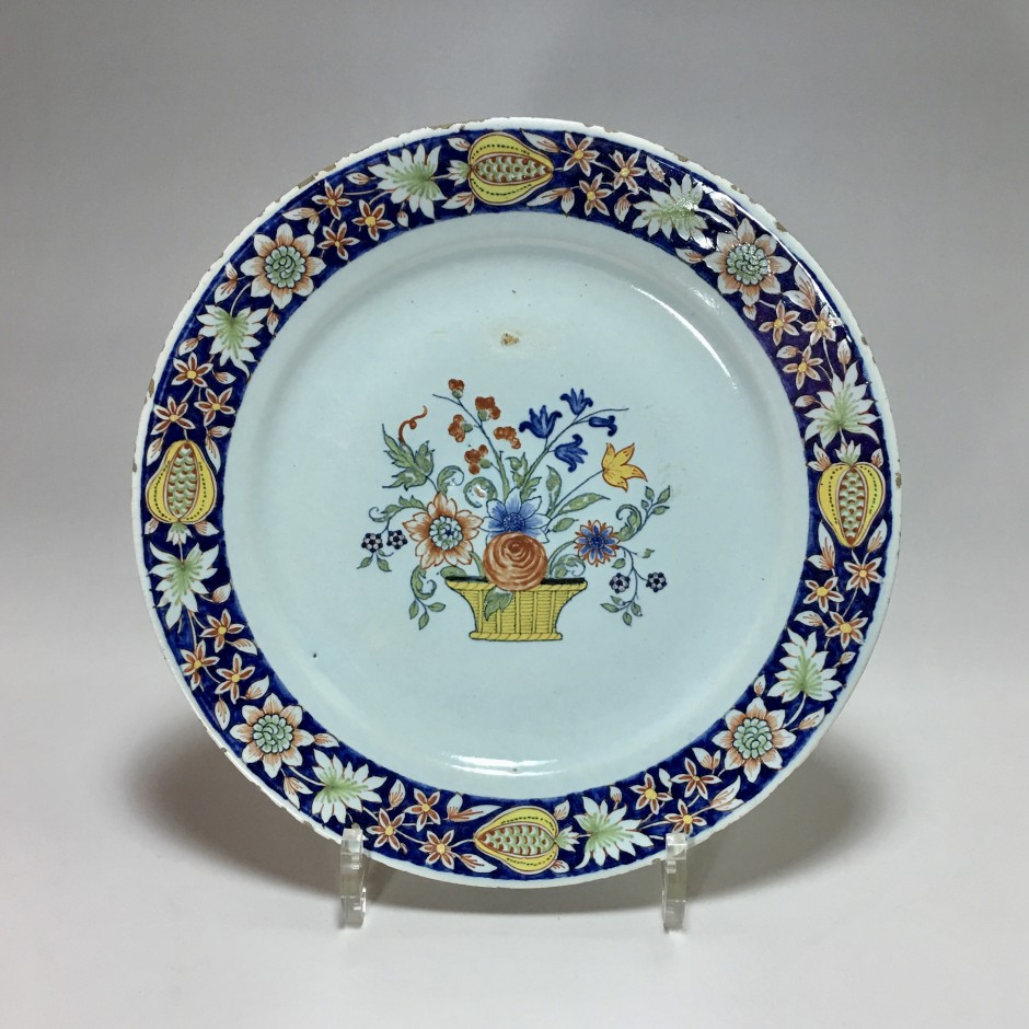 ROUEN - Plate with flower basket - eighteenth century