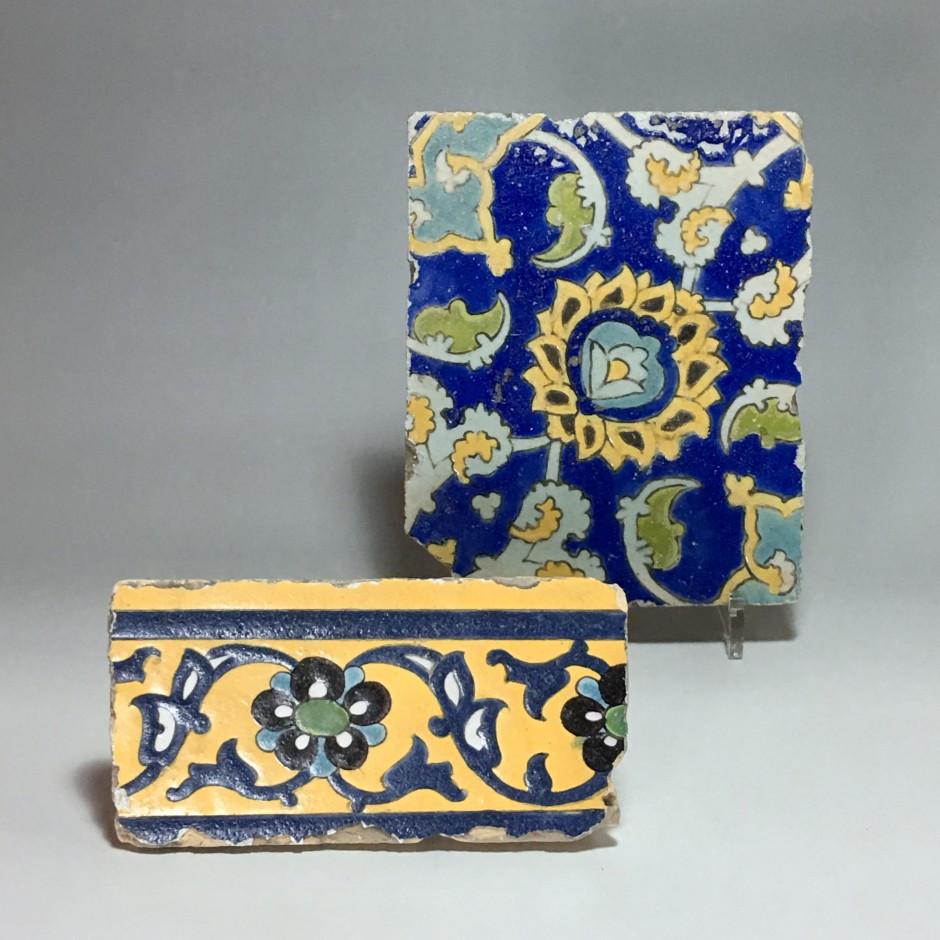 "Two polychrome floral decoration tiles in style ""cuerda seca"" - Iran - Safavid Art - Seventeenth century."