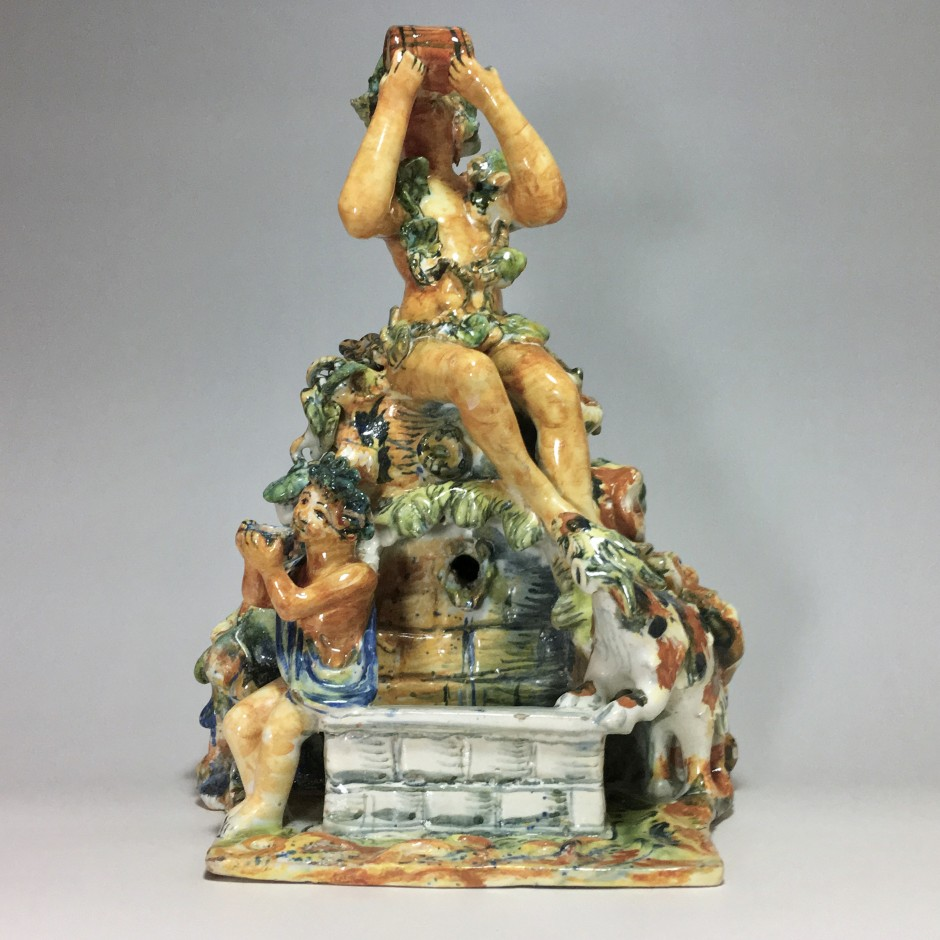 Fountain depicting Bacchus in majolica from Urbino, Patanazzi workshop circa 1580.