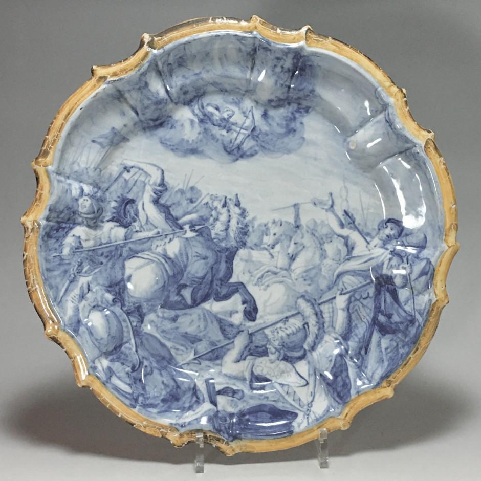 Plat en faïence de Lodi (Italie) - Décor d'une scène de bataille - XVIIIe siècle