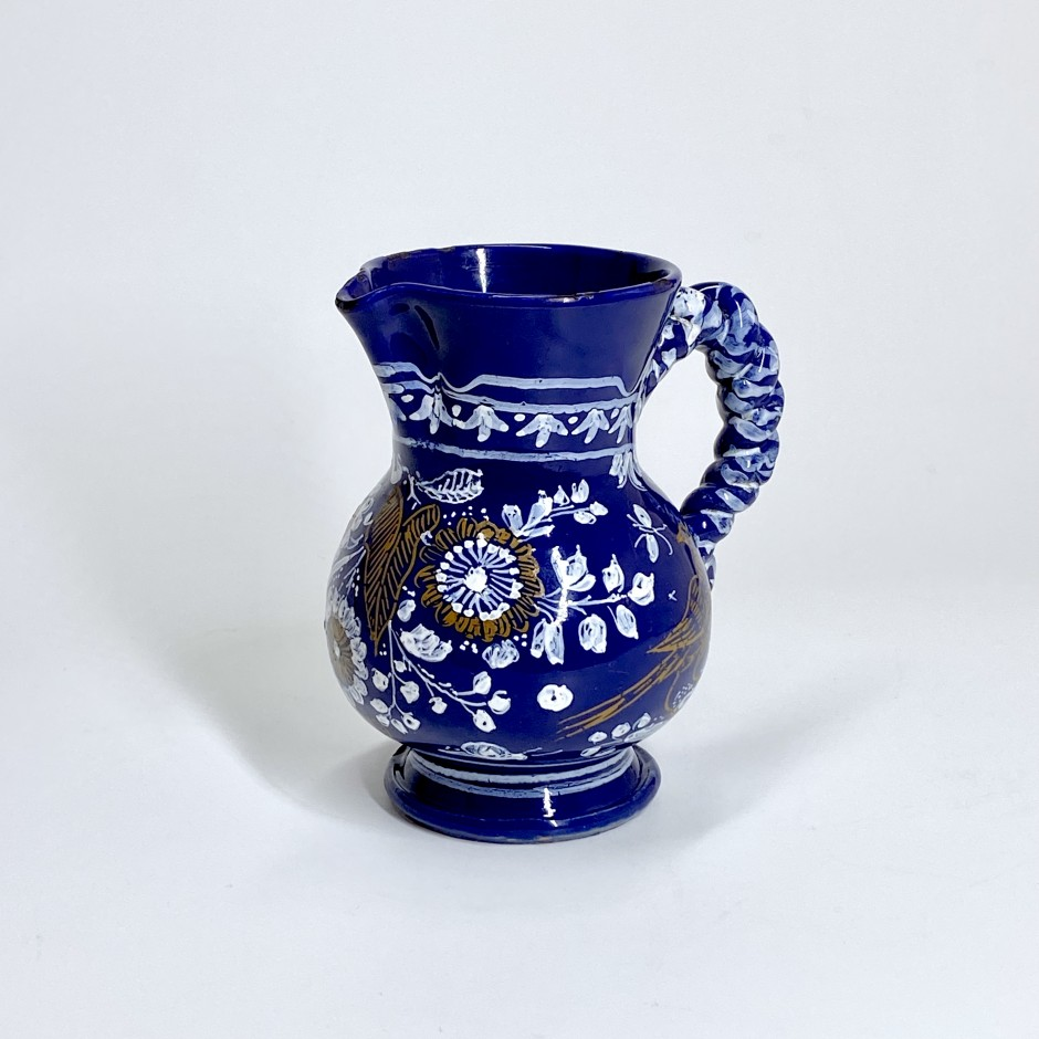Nevers. Small earthenware pitcher with Persian blue background - Seventeenth century - Circa 1650